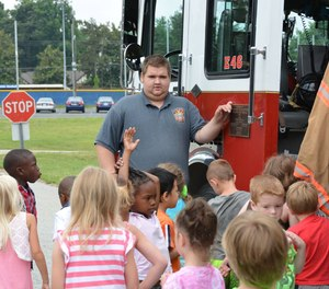 Firefighter Corey Spencer shows young visitors around the Pinecroft Sedgefield Fire Department in 2015.