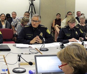 Honolulu Police Chief Louis Kealoha, center, addresses Hawaii lawmakers during hearing in Honolulu. (Photo/AP)