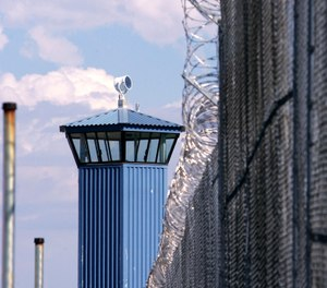 In this Aug. 31, 2007, file photo, a guard tower is seen behind the wire fence that surrounds California State Prison, Sacramento, in Folsom, Calif. (AP Photo/Rich Pedroncelli, File)