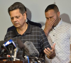Kevin French reacts as his father, Russell French, describe the family's ordeal during a news conference in Corona, Calif., Monday, Aug. 26, 2019. (Jeff Gritchen/The Orange County Register via AP)