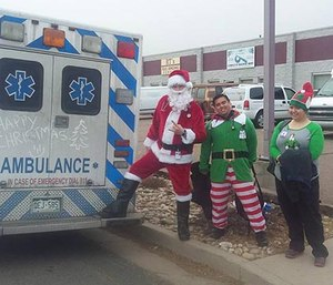 EMTs from Citywide Ambulance dressed up as Santa and elves while assisting patients. (Mercedes Lane Facebook photo)