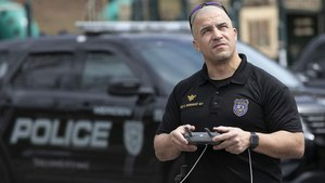 Police Sgt. Christian Rodriguez operates a drone at Hubbard Park in Meriden, Connecticut, last month. Several police departments during the coronavirus outbreak mounted speakers on drones to alert the public to social distancing guidelines. Image: Dave Zajac/Record-Journal via AP