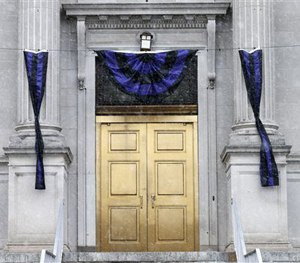 Memorial bunting adorns the entrance to City Hall in Linden, N.J. Friday, March 20, 2015. (AP Image)