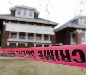 Crime scene tape surrounds a home Friday, Feb. 5, 2016, in Chicago.