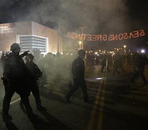 Police officers approach protesters Tuesday, Nov. 25, 2014, in Ferguson, Mo.