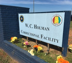 The sign outside Alabama's Holman Correctional Facility, a maximum security prison in Atmore that is soon to be partially closed, despite concerns the closure will increase the state's overcrowding problem.