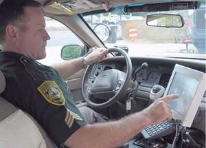 Police officers run the risk of being more distracted than most. (File Photo)