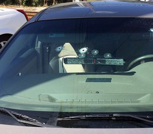 The unmarked patrol vehicle with gunshot holes. (Jacksonville Sheriff's Office Image)