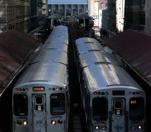 A spike in crime on Chicago's rail system and some recent high profile outbursts of violence has prompted the city's police department to put dozens more officers in trains and on platforms. (Photo/AP)