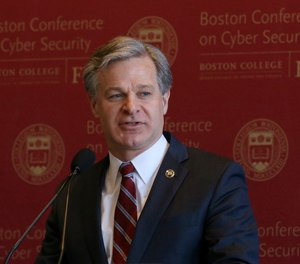 FBI Director Christopher Wray delivers the keynote address at a conference on cybersecurity on Wednesday, March 4, 2020, at Boston College.