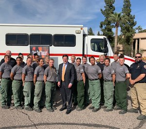 Arizona Gov. Doug Ducey (center) signed into law this month a new initiative to train 700 inmates as wildland firefighters. Ducey met with an all-female inmate fire crew in 2019 to recognize their efforts.