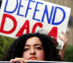 Loyola Marymount University student and dreamer Maria Carolina Gomez joins a rally in support of the Deferred Action for Childhood Arrivals, or DACA program, outside the Edward Roybal Federal Building in Los Angeles. (AP Photo/Damian Dovarganes)