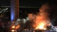 Firefighters battle massive Dallas condo fire