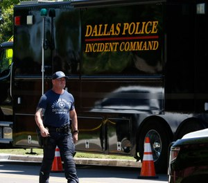 A Dallas SWAT officer walks near the scene of home on Highcrest Drive after a domestic violence call-turned-murder-suicide early Monday morning on May 18, 2020. (Photo/TNS)