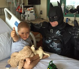 Officer Damon Cole hangs out with 4-year-old Max Brown, who is undergoing treatment for acute lymphoblastic leukemia.
