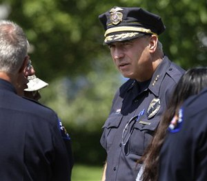 Aurora Police Chief Dan Oates talks to guests at the funeral for Aurora, Colo., movie theater shooting victim AJ Boik, Friday, July 27, 2012.