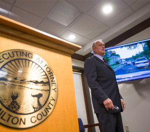 Ohio prosecutor Joe Deters explains a dash cam video during a news conference regarding the investigation into the shooting death of Cincinnati Police Department Officer Sonny Kim.