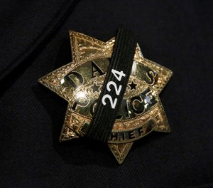 The badge of Davis Police Chief Darren Pytel is shown before funeral services for Davis Police Officer Natalie Corona at the University of California, Davis, Friday, Jan. 18, 2019, in Davis, Calif. (AP Photo/Rich Pedroncelli, pool)