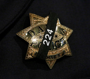 The badge of Davis Police Chief Darren Pytel is shown before funeral services for Davis Police Officer Natalie Corona at the University of California, Davis, Friday, Jan. 18, 2019, in Davis, Calif.