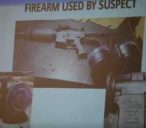 The firearm used by the shooter Connor Betts, 22, is projected on a screen during a press conference Sunday, Aug. 4, 2019. (Albert Cesare/The Cincinnati Enquirer via AP)