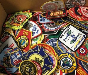 Lt. Jonathan Evans with MBFD said the department is donating hundreds of patches to Mileena that have been collected over the course of nearly 20 years.