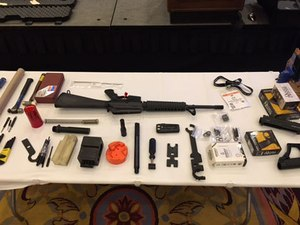 A Vietnam-era AR rifle with some of the parts and tools needed to modernize it. (Photo/PoliceOne)