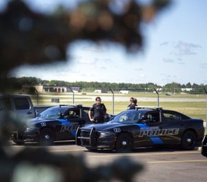 Burton Police Officers gather at Bishop International Airport, Wednesday morning, June 21, 2017, in Flint, Mich. (Shannon Millard/The Flint Journal-MLive.com via AP)