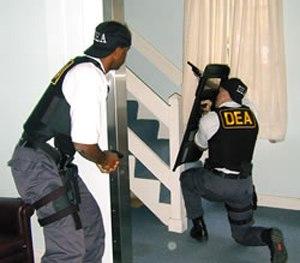 DEA agents participate in a training scenario.