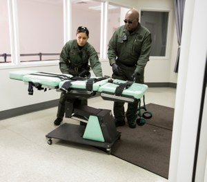 In this photo provided by the California Department of Corrections and Rehabilitation a gurney is removed from the death penalty chamber at San Quentin State Prison, Wednesday, March 13, 2019, in San Quentin, Calif. (California Department of Corrections and Rehabilitation via AP)