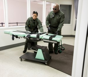 In this March 13, 2019, file photo, provided by the California Department of Corrections and Rehabilitation, a gurney is removed from the death penalty chamber at San Quentin State Prison in San Quentin, Calif. (California Department of Corrections and Rehabilitation via AP, File)