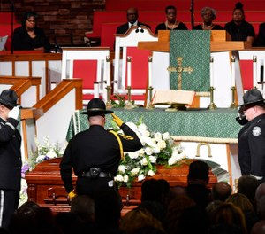 Officers salute the casket during the funeral of Debra Johnson at Temple Church Friday, Aug. 16, 2019, in Nashville, Tenn. Johnson was a former Tennessee Department of Correction administrator slain earlier in the month. (Larry McCormack/The Tennessean via AP, Pool)