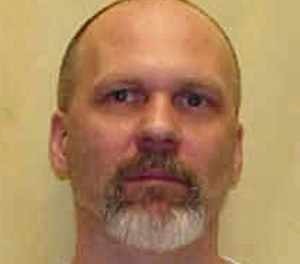 This undated photo provided by the Ohio Department of Rehabilitation and Corrections shows Warren Keith Henness. The Ohio Parole Board on Friday, Jan. 18, 2019 rejected a clemency request by Henness, a condemned killer who says he's innocent of the fatal shooting of a volunteer addiction counselor and is asking that his life be spared. Henness was convicted of killing 51-year-old Richard Meyers in Columbus in 1992. (Ohio Department of Rehabilitation and Corrections via AP)