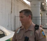 Fla. police officer helps homeless family return to Mich.