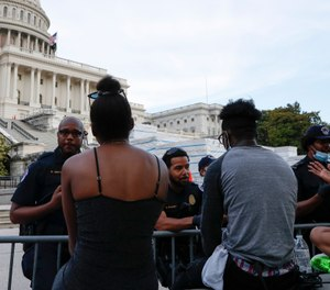U.S. Capitol police officers talk with demonstrators as they have a conversation about racism in America as they protest the death of George Floyd, Wednesday, June 3, 2020, on Capitol Hill in Washington. (Photo/AP)