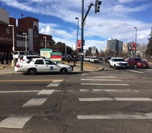 In this photo provided by 9NEWS/KUSA-TV Denver, authorities respond to the scene of a deadly shooting and stabbing at the National Western Complex, Saturday, Jan. 30, 2016, in Denver. (9NEWS/KUSA-TV Denver via AP)