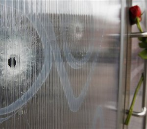 Bullet holes are seen in the window of the cultural center one of the locations of the weekend shootings in Copenhagen, Denmark, Tuesday, Feb. 17, 2015. (AP Image)