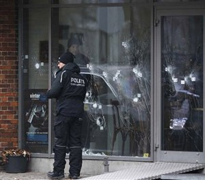 Police investigators work at the scene of Saturday's shooting at a free speech event in Copenhagen, Sunday, Feb. 15, 2015. (AP Image)
