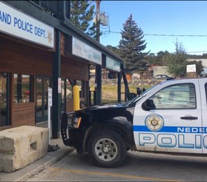 FILE - This Oct. 13, 2016 file photo shows the exterior of the police station in Nederland, Colo. where David Ansberry left a homemade bomb that failed to detonate. On Friday, Jan. 25, 2019 Ansberry was sentenced to 27 years in prison after a judge concluded the device was left to avenge the killing of a friend in 1971 by the town marshal and should be treated as an act of terrorism.
