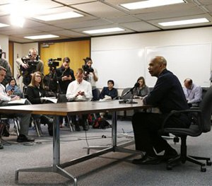 Denver Police Department Chief Robert White, right, responds to questions during a news conference in Denver, Thursday, Jan. 29, 2015, about the death of a 17-year-old woman who was killed after she allegedly hit and injured a Denver Police Department officer while driving a stolen vehicle early Monday in a northeast Denver alley. (AP Image)
