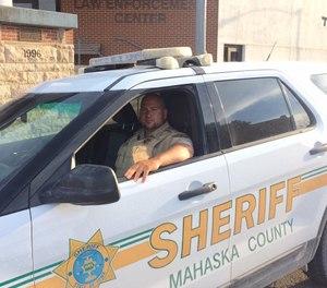 Deputy Brian Rainey sits in a Mahaska County Sheriff's Office vehicle. (Photo/Mahaska County Sheriff's Office)