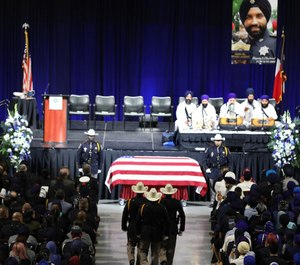 Police officers from Texas, Louisiana, New York and Canada were some of thousands who gathered to remember HSCO Deputy Sandeep Dhaliwal.