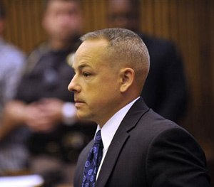 In this June 18, 2013 file photo, Detroit police officer Joseph Weekley stands in Judge Cynthia Hathaway's courtroom at the Frank Murphy Hall of Justice in Detroit. (AP Image)