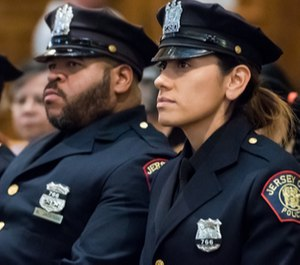 Officers Raymond Sanchez, (not pictured), Kendric Jackson, right, and Mariela Fernandez to the rank of detective following their heroic actions during a shooting at a kosher deli on Dec.10, 2019. (Photo/TNS)