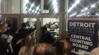 Detroit police push back rowdy poll challengers at vote count center