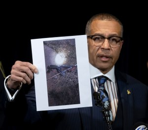 "Detroit Police Chief James Craig shows a photograph of an ""assault-type weapon"" used by the suspect as he speaks to the media at Detroit Public Safety Headquarters. (Photo/AP)"