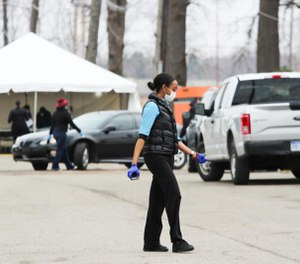 Drive-thru COVID-19 testing began at the former Michgian State Fairgrounds on Friday. Duggan says he wants to expand testing criteria so more people can be tested onsite. (Photo/TNS)