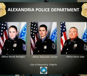 A poster shows images of Alexandria, Va. Police Officers, from left, Nicole Battaglia, Alexander Jensen, and Kevin Jobe, during a news conference at the Police Headquarters in Alexandria, Va., Monday, June 19, 2017, about the June 14 shooting at a baseball field in Alexandria. (AP Photo/Jacquelyn Martin)