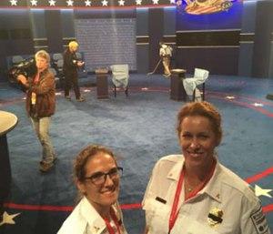 Sabina Braithwaite, MD Deputy Chief of Washington University EMS, and Maia Dorsett, MD 2016 Fellow in EMS Medicine, in the debate hall.