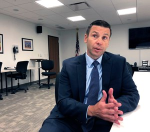 """Kevin K. McAleenan, U.S. acting secretary of Homeland Security, speaks Tuesday, Aug. 13, 2019, at a federal building in Jackson, Miss. McAleenan said """"violent white supremacist ideology"""" is fueling some domestic terrorism."""
