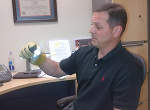 Greg Price, S&T's First Responders Group program manager, demonstrates the new glove.